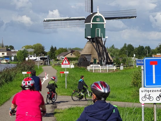 Cyclist close to a Windmill